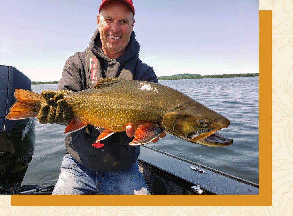 Gord Ellis holding a nipigon brook trout fish